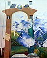 """Alzey - Hinterhofmalerei in auf einer Hauswand in Alzey – """"Das Tor zur Welt"""" - panoramio (1).jpg"""