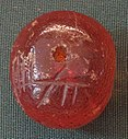 Amber bead with ogham inscription.jpg