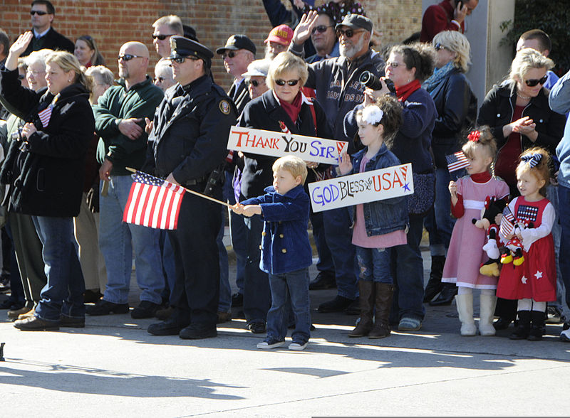 File:An American boy waves a U.S. flag during a Veterans Day parade in Knoxville, Tenn., Nov. 11, 2011 111111-A-IL912-057.jpg