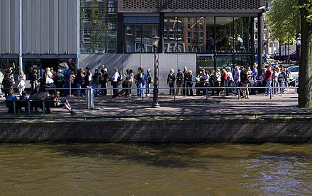 People waiting in line in front of the Anne Frank House entrance in Amsterdam