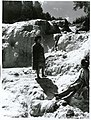 Auckland Province - Waiotapu Publicity Caption The Bridal Veil Falls at Waiotapu make a background for two Maori girls, Rotorua Photographer R Anderson.jpg