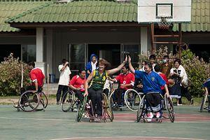 Liesl Tesch - Tesch conducting wheelchair basketball clinics in Vientiane, Laos (2010)