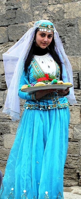 Azerbaijani traditional clothing - Azerbaijani girl in national costume at Nowruz holiday in Baku