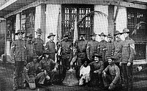 Balangiga bells - American survivors of the Balangiga massacre pose with a Balangiga bell. Photo taken in Calbayog, Samar, in April 1902