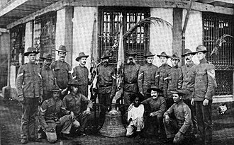 Balangiga, Eastern Samar - U.S. soldiers of Company C, 9th Infantry Regiment pose with one of the Balangiga bells seized as war trophy. Photo taken in Calbayog, Samar in April 1902.