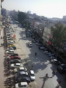 Day time view of Bank Road from Shahbaz Plaza