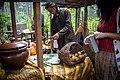 Bapak menjual jagung bakar dengan pakaian adat jawa.jpg