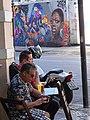 Bar Patrons with Wall Mural - Centro - Rio de Janeiro - Brazil (17470692075).jpg