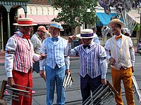 Four members of a barbershop quartet standing around