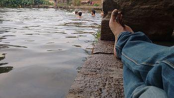 Bathing in the heritage water source.jpg