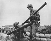 Comparing the earlier M9 bazooka to the later, larger M20 model.
