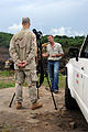Beau Davis, site program coordinator for the Norman Borlaug Institute for International Agriculture, explains the vision of the land behind him to U.S. Air Force Tech. Sgt. Shane Cronin, a combat camera 100505-F-FW561-172.jpg