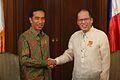 Benigno S. Aquino III shakes hand with Joko Widodo.jpg
