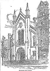 "A drawing of the facade of a two or three story building obliquely faces the reader. The facade has three bays, and the roof is steeply sloped. The central bay has a large arched recessed entrance-way, with two tall narrow arched windows on top of it, and a rose window on top of them. Along the arch of the entrance-way are the words ""Congregation Beth Elohim"". The central bay is separated from the side bays by tall narrow rectangular towers, whose peaks match the height of the central peak of the roof. The side bays have one arched window over two smaller arched windows, and at the corners of the building are short narrow rectangular towers."