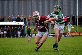 2014 Galway Senior Hurling Championship - Billy Lane of Clarinbridge and David Headd of Mullagh in action in the opening game of the 2014 Galway Senior Hurling Championship