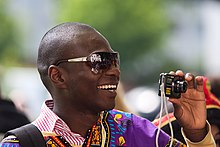 Black man taking a photo at ISWI 2009.jpg
