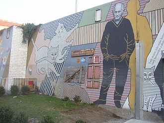 "Libeň - Bohumil Hrabal painted among his beloved cats on the ""Hrabal Wall"" in Prague"