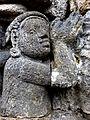 Borobudur - Lalitavistara - 023 S, The Sakyans give gifts to the Poor (detail 3) (11247522095).jpg