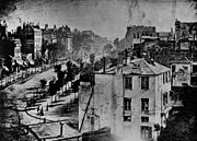 First photograph including a person, by Daguerre, 1838 or 1839