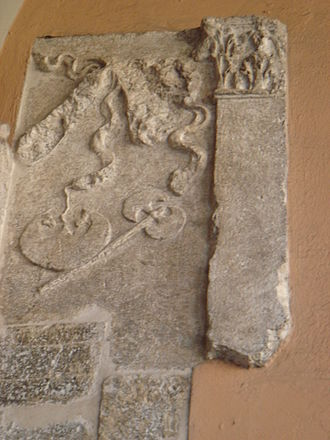 Axe - Roman axe in an ancient Roman relief in Brescia, Italy