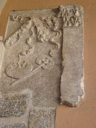 Axe - Roman axe in an ancient Roman relief in Brescia, Italy