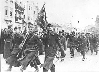 World War II in Yugoslav Macedonia - Partisans of the Goce Delčev Brigade marching through Skopje in November 1944.