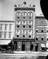 Briggs Hardware, Macabbee Club, Bridgers Tailor, Fayetteville Street, Raleigh, NC, c.1900-1915. Dughi Ice Cream ad in lower right corner. Original glass plate negative is from the J. C. Knowles (8721754496).jpg