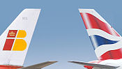 Эмблемы авиакомпаний British Airways и Iberia Airlines