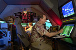 Bruce Golson and Jay Kealhofer demonstrate a simulated emergency aircraft scenario for KC-135 Stratotanker.JPG