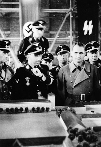 Heinrich Himmler - Himmler and Rudolf Hess in 1936, viewing a scale model of Dachau concentration camp.