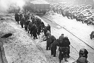 The Holocaust in Belarus - Jewish prisoners of the Minsk Ghetto clearing snow at the station, February 1942