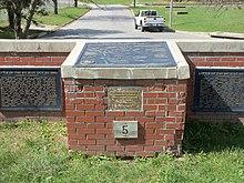 Metal tablets on a brick wall
