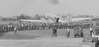 RAF Spanhoe - 82d Airborne parachutists loading onto 43d and 309th TCS aircraft, 1944.