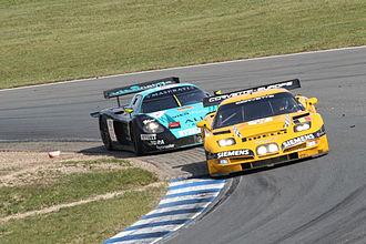 2005 FIA GT Championship - A GLPK-Carsport Corvette C5-R leads a Vitaphone Racing Team Maserati MC12 at the Oschersleben round of the 2005 FIA GT Championship