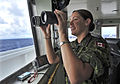 Canadian Navy Lt. Lois Lane assists with look-out duties in the pilothouse of the hospital ship USNS Mercy (T-AH 19) after completing a four and a half month mission during Pacific Partnership in the Pacific 120827-N-KW566-004.jpg