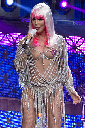 "Cher singles discography - Cher performing her biggest-selling single ""Believe"" during the Dressed to Kill Tour in 2014"