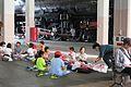Children eating on the Umekoji Locomotive Depot Roundhouse floor 2016-10-06.jpg