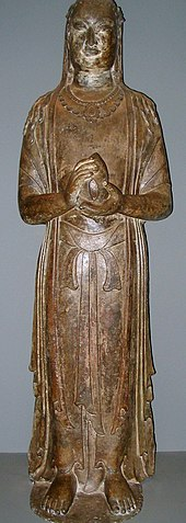 A limestone statue of the Bodhisattva, from the Northern Qi Dynasty, 570 AD, made in what is now modern Henan province.