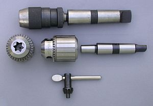 Chuck (engineering) - Top: an assembled keyless chuck. This type of chuck is tightened by twisting the body using firm hand pressure only. While convenient, this feature can cause the chuck to loosen if too much torque is applied. Bottom: the widely used keyed type of drill chuck with its key. The arbor is shown separately to the right. These chucks require a toothed key to provide the necessary torque to tighten and loosen the jaws. When the key is turned its teeth mate with teeth on the chuck, turning an internal screw which in turn moves the threaded jaws in or out along a tapered surface. The taper allows the jaws to clamp drill shanks of a range of diameters. The end view shows the three small jaws that slide within the body.