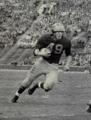 Chuck Ortmann running with ball.png