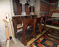 Church of the Holy Trinity - choir stalls and candle - East Grimstead, Wiltshire, England.jpg