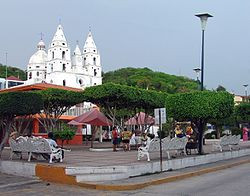 Town square in Cihuatl�n, showing church building and plaza.