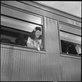 Closing of the Jerome Relocation Center, Denson, Arkansas. An attractive miss, aboard the train for . . . - NARA - 539797.tif