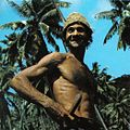 Coconut plantation worker Seychelles.jpg