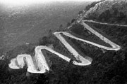 Mountain road with hairpin turns in the French Alps