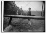 Coolidge inspecting one of world flight planes t.tif