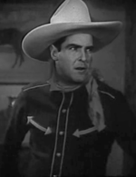 Ken Maynard Cropped screenshot of Ken Maynard in In Old Santa Fe film, 1934.png