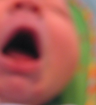 Infant crying - A baby crying, 6 months after birth.