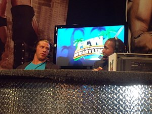 Byron Saxton - Saxton (right) with Curt Hawkins commentating in FCW