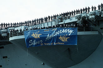 USS John F. Kennedy (CV-67) - A close-up view of the banner hanging from the starboard bow missile sponson of John F. Kennedy, 7 April 1993.